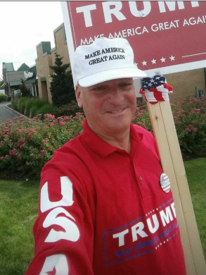 Eric Bostrom sporting a red-colored Donald Trump Make America Great Again shirt, and a white Make America Great Again hat